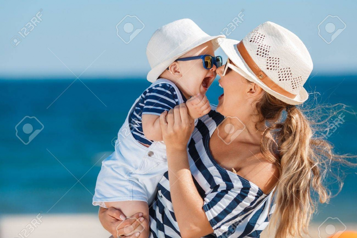 46804884-the-happy-family-relaxing-near-the-sea-young-mother-with-the--Stock-Photo